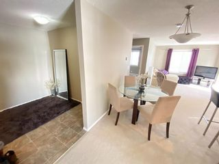 Photo 2: 302 5 SADDLESTONE Way NE in Calgary: Saddle Ridge Apartment for sale : MLS®# A1075691