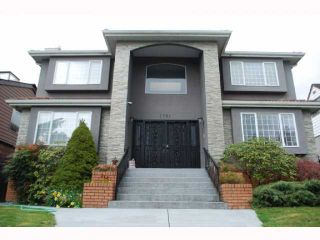 "Photo 1: 1741 E 59TH Avenue in Vancouver: Fraserview VE House for sale in ""FRASERVIEW"" (Vancouver East)  : MLS®# V845445"