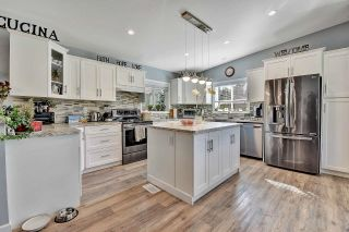 Photo 2: 26568 62ND Avenue in Langley: County Line Glen Valley House for sale : MLS®# R2618591