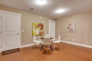 Photo 30: 34 Cougar Ridge Landing SW in Calgary: Cougar Ridge Row/Townhouse for sale : MLS®# A1075174