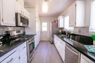 Photo 8: DEL CERRO House for sale : 3 bedrooms : 5355 Fontaine St in San Diego