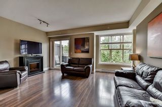 "Photo 3: 211 2110 ROWLAND Street in Port Coquitlam: Central Pt Coquitlam Townhouse for sale in ""AVIVA ON THE PARK"" : MLS®# R2094344"