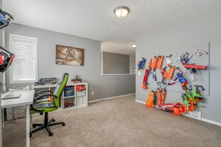 Photo 21: 88 COUGARSTONE Manor SW in Calgary: Cougar Ridge Detached for sale : MLS®# A1022170