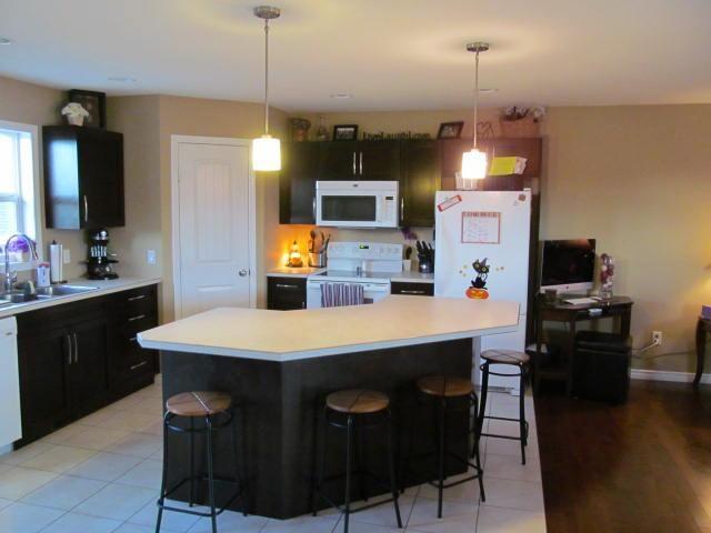 Photo 2: Photos: 8904 118A Avenue in Fort St. John: Fort St. John - City NE House for sale (Fort St. John (Zone 60))  : MLS®# N240348