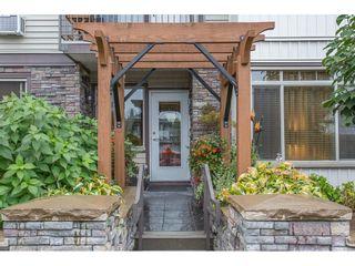 "Photo 1: 118 11887 BURNETT Street in Maple Ridge: East Central Condo for sale in ""WELLINGTON STATION"" : MLS®# R2213469"