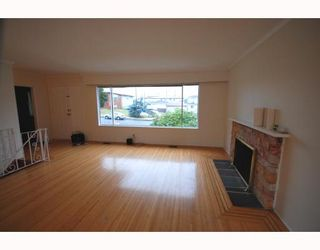 Photo 4: 4538 MANOR Street in Vancouver: Collingwood VE House for sale (Vancouver East)  : MLS®# V768767