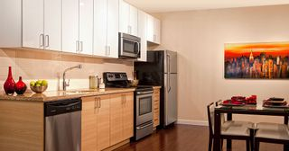 "Photo 4: 208 3688 Inverness Street in Vancouver: Condo for sale in ""Charm"""