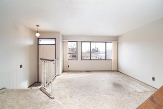 Photo 2: 5 903 67 Avenue SW in Calgary: Kingsland Row/Townhouse for sale : MLS®# A1079413