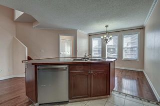 Photo 11: 64 Eversyde Circle SW in Calgary: Evergreen Detached for sale : MLS®# A1090737