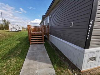 "Photo 2: 8711 74 Street in Fort St. John: Fort St. John - City SE Manufactured Home for sale in ""SOUTH ANNOEFIELD"" (Fort St. John (Zone 60))  : MLS®# R2553301"