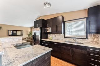 Photo 7: 219 Riverbirch Road SE in Calgary: Riverbend Detached for sale : MLS®# A1109121
