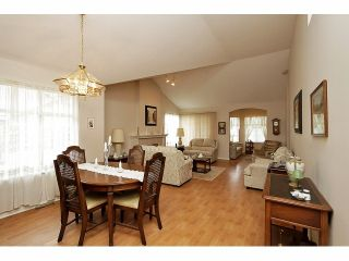 """Photo 3: 115 19649 53RD Avenue in Langley: Langley City Townhouse for sale in """"Huntsfield Green"""" : MLS®# F1406703"""