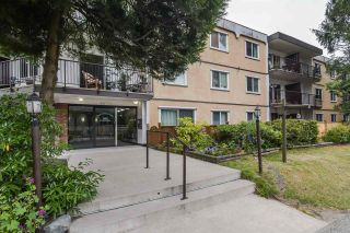 "Photo 1: 205 630 CLARKE Road in Coquitlam: Coquitlam West Condo for sale in ""King Charles Court"" : MLS®# R2387151"