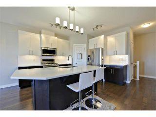Photo 8: 140 FIRESIDE Place: Cochrane House for sale : MLS®# C4004650