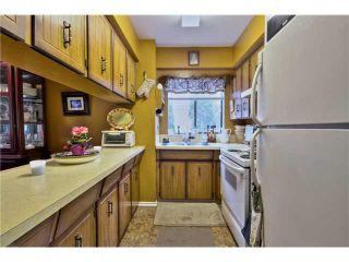 "Photo 7: 7963 138A Street in Surrey: East Newton House for sale in ""BEAR CREEK"" : MLS®# F1405445"