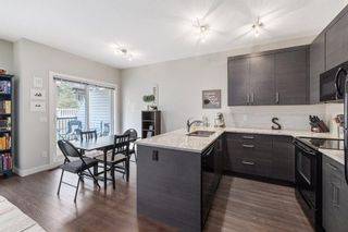 Photo 8: 205 Jumping Pound Common: Cochrane Row/Townhouse for sale : MLS®# A1138561
