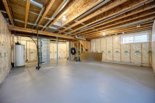 Photo 11: 76 Brightoncrest Rise SE in Calgary: New Brighton Detached for sale : MLS®# A1153438