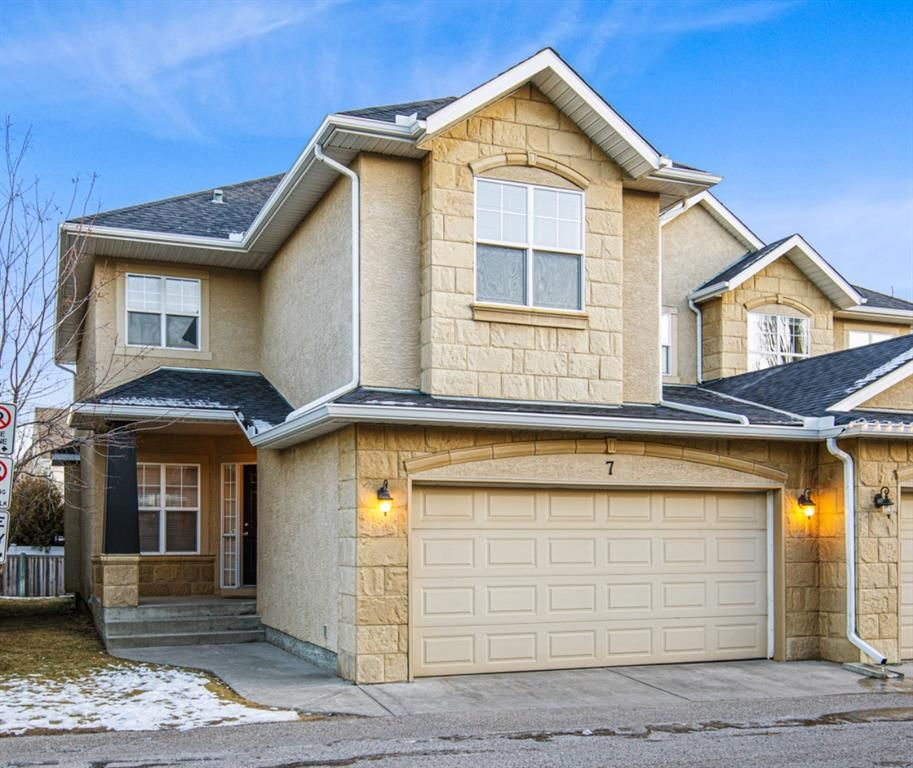 Main Photo: 7 39 Strathlea Common SW in Calgary: Strathcona Park Semi Detached for sale : MLS®# A1056254