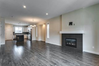 Photo 7: 134 Cooperswood Place SW: Airdrie Semi Detached for sale : MLS®# A1129880
