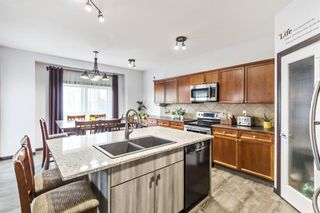 Photo 4: 19 Everhollow Crescent SW in Calgary: Evergreen Detached for sale : MLS®# A1099743