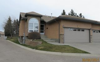Photo 1: 24 Shannon Estates Terrace SW in Calgary: Shawnessy Row/Townhouse for sale : MLS®# A1102178