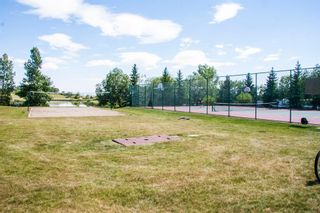 Photo 36: 93 Rocky Vista Circle NW in Calgary: Rocky Ridge Row/Townhouse for sale : MLS®# A1071802