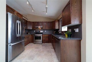 Photo 7: 77 WEST EDGE Road: Cochrane House for sale : MLS®# C4177581