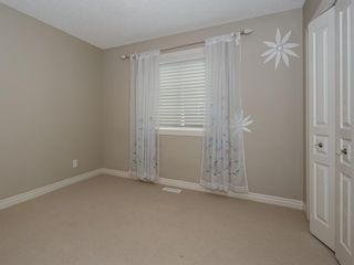 Photo 19: 27 Cougar Plateau Way SW in Calgary: Cougar Ridge Detached for sale : MLS®# A1113604