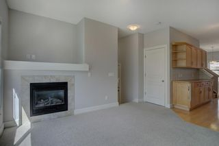 Photo 11: 76 Bridleridge Manor SW in Calgary: Bridlewood Row/Townhouse for sale : MLS®# A1106883
