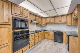 Photo 11: 10 Coach  Manor Rise SW in Calgary: Coach Hill Row/Townhouse for sale : MLS®# A1077472