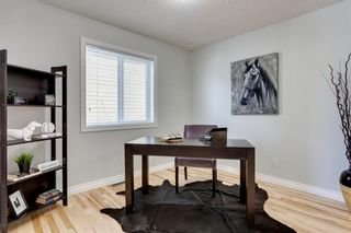 Photo 5: 12469 Crestmont Boulevard SW in Calgary: Crestmont Detached for sale : MLS®# A1109219