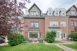 Photo 2: 191 Ypres Green SW in Calgary: Garrison Woods Row/Townhouse for sale : MLS®# A1140623