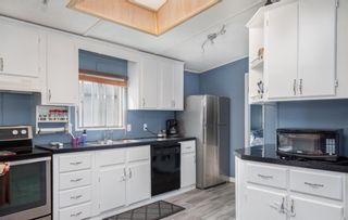 Photo 6: 111 Heritage Drive: Okotoks Mobile for sale : MLS®# A1102220
