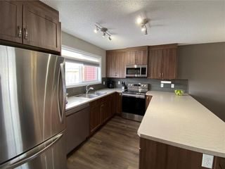 Photo 6: 21 RIVER HEIGHTS Link: Cochrane Row/Townhouse for sale : MLS®# C4286639