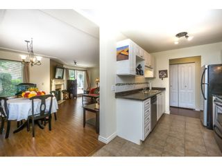 """Photo 3: 102 20433 53 Avenue in Langley: Langley City Condo for sale in """"COUNTRYSIDE ESTATES III"""" : MLS®# R2103607"""