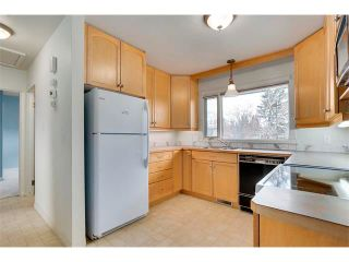 Photo 11: 3039 CANMORE Road NW in Calgary: Banff Trail House for sale