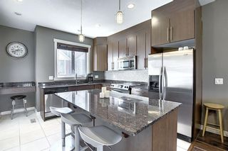 Photo 5: 47 WEST SPRINGS Lane SW in Calgary: West Springs Row/Townhouse for sale : MLS®# A1039919