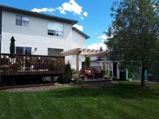 Photo 2: 21 Bow Ridge Crescent: Cochrane Detached for sale : MLS®# A1079980