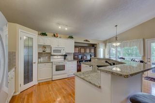 Photo 7: 113 Bailey Ridge Place SE: Turner Valley House for sale : MLS®# C4126622