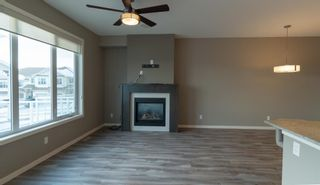 Photo 9: 250 Sunset Point: Cochrane Row/Townhouse for sale : MLS®# A1050873