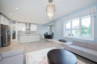 Photo 8: 48 Tremblant Terrace SW in Calgary: Springbank Hill Detached for sale : MLS®# A1131887