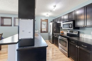 Photo 9: 22 BRIDLECREST Garden SW in Calgary: Bridlewood Detached for sale : MLS®# C4306282