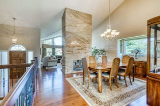 Photo 8: 555 Coach Light Bay SW in Calgary: Coach Hill Detached for sale : MLS®# A1144688