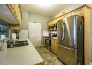 "Photo 4: 424 13880 70TH Avenue in Surrey: East Newton Condo for sale in ""CHELSEA GARDENS"" : MLS®# F1445932"