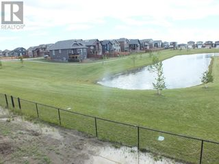 Photo 29: 504 Greywolf Cove N in Lethbridge: House for sale : MLS®# A1153214