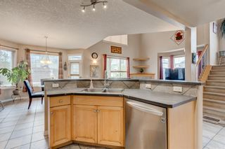 Photo 5: 250 Elmont Bay SW in Calgary: Springbank Hill Detached for sale : MLS®# A1119253