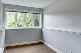 Photo 33: 32 Bow Village Crescent NW in Calgary: Bowness Detached for sale : MLS®# A1138137