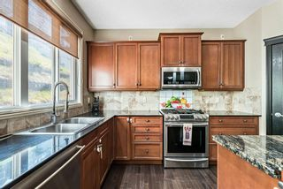 Photo 9: 157 Springbluff Boulevard SW in Calgary: Springbank Hill Detached for sale : MLS®# A1129724