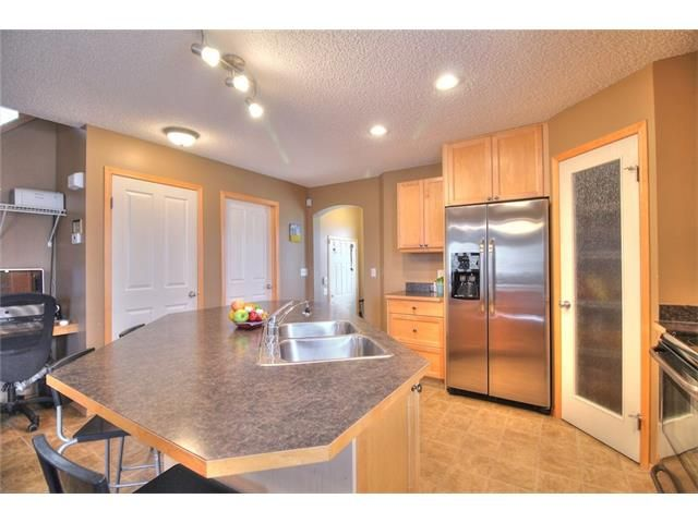 Photo 11: Photos: 304 EVERSYDE Circle SW in Calgary: Evergreen House for sale : MLS®# C4035934