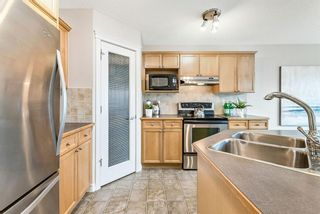 Photo 8: 22 CRYSTAL SHORES Heights: Okotoks Detached for sale : MLS®# A1012780